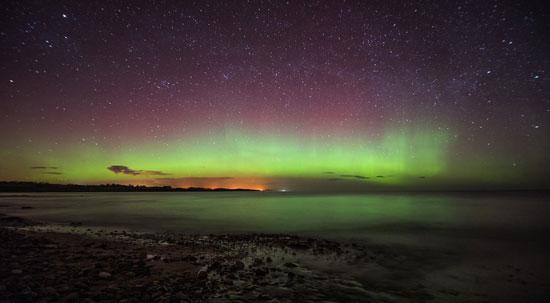 [بالصور] شاهد ظاهرة الانوار القطبية في سماء اسكتلندا