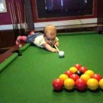 Baby-learns-to-play-pool-resizecrop--